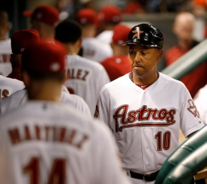 In this file photo, Houston Astros first base coach Bobby Meacham (10) walks through the dugout after the Houston Astros lost to the Pittsburgh Pirates in a baseball game Saturday, July 28, 2012 in Houston. (AP Photo/Eric Kayne)