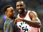 Toronto Raptors forward Patrick Patterson (54) reacts with teammate Toronto Raptors guard Norman Powell after hitting a half-court three pointer to beat the buzzer during first half NBA basketball action in Toronto on Monday, Nov. 28, 2016. (The Canadian Press/Nathan Denette)
