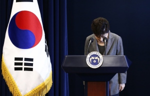 South Korean President Park Geun-hye bows during her address to the nation at the presidential Blue House in Seoul, Tuesday, Nov. 29, 2016. (Pool Photo via AP)