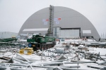 A view of the half-cylinder-shaped enclosure in Chernobyl, Ukraine, Tuesday, Nov. 29, 2016. (AP Photo/Efrem Lukatsky)
