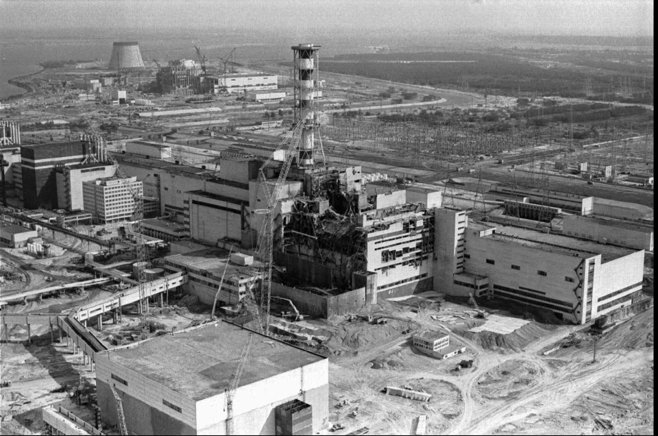 This 1986 file photo shows an aerial view of the Chernobyl nuclear plant in Chernobyl, Ukraine showing damage from an explosion and fire in reactor four on April 26, 1986 that sent large amounts of radioactive material into the atmosphere. A massive shelter has finally been installed over the exploded reactor at the Chernobyl nuclear plant, one of the most ambitious engineering projects in the world. The half-cylinder-shaped shelter began being moved toward the reactor on a system of hydraulic jacks two weeks ago and reached its destination Tuesday, Nov. 29, 2016 a significant step toward liquidating the remains of the world's worst nuclear accident, 30 years ago in what is now Ukraine. (AP Photo/Volodymyr Repik, File)