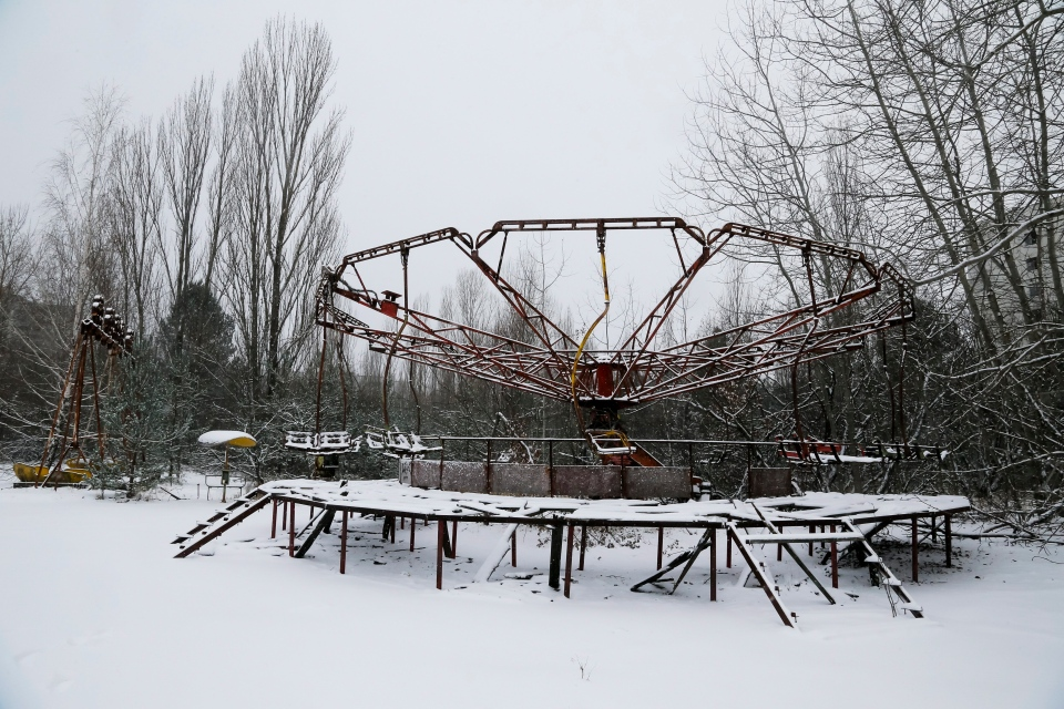 A playground is seen in the deserted town of Pripyat, some 3 kilometers (1.86 miles) from the Chernobyl nuclear plant in Ukraine, Tuesday, Nov. 29, 2016. A massive shelter has finally been installed over the exploded reactor at the Chernobyl nuclear plant, one of the most ambitious engineering projects in the world. The half-cylinder-shaped shelter began being moved toward the reactor on a system of hydraulic jacks two weeks ago and reached its destination Tuesday, a significant step toward liquidating the remains of the world's worst nuclear accident, 30 years ago in what is now Ukraine. (AP Photo/Efrem Lukatsky)