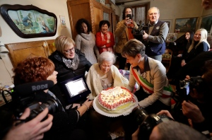 Verbania's Mayor Silvia Marchionini, right, presents Emma Morano with a cake in the day of her 117th birthday in Verbania, Italy, Tuesday, Nov. 29, 2016. At 117 years of age, Emma is now the oldest person in the world and is believed to be the last surviving person in the world who was born in the 1800s, coming into the world on Nov. 29, 1899. (AP Photo/Antonio Calanni)