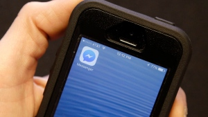 A mobile phone showing the Facebook Messenger app icon in San Francisco, on July 27, 2016. (Jeff Chiu / AP)
