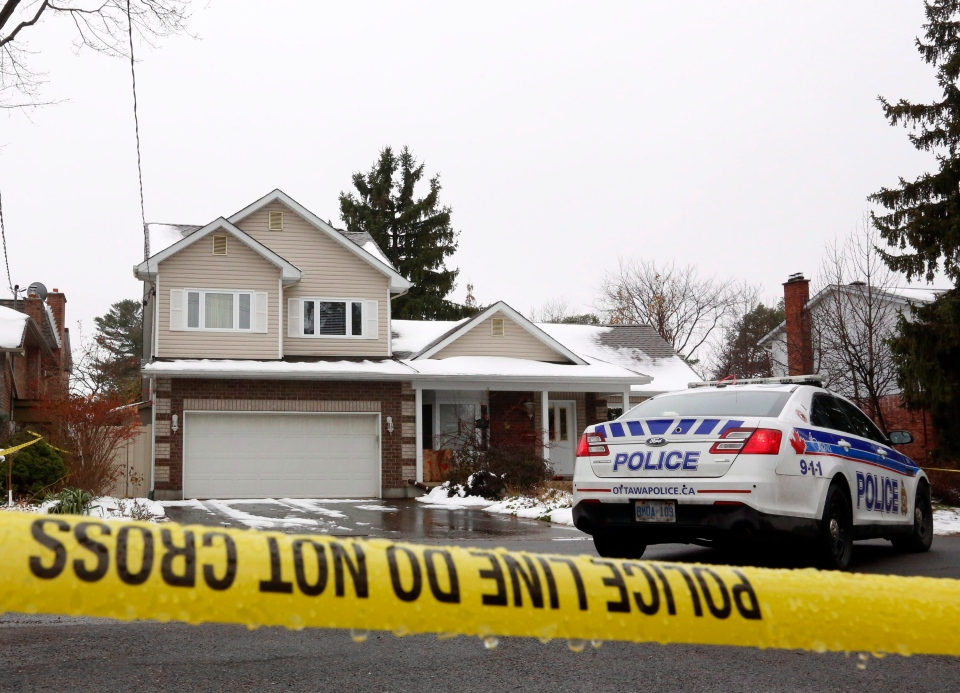 A police cruiser and police tape surround a home in Ottawa, Tuesday, November 29, 2016. A 22-year-old man has been charged with first-degree murder after his parents were found dead at the home on Monday night. THE CANADIAN PRESS/Fred Chartrand