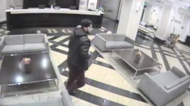 A suspect in a Nov. 5 robbery and sex assault is seen in surveillance footage. (Toronto Police)