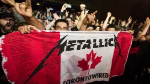 Fans cheer as Metallica plays at the Opera House, a small venue with a 950 person capacity, in Toronto, Tuesday November 29, 2016. THE CANADIAN PRESS/Mark Blinch