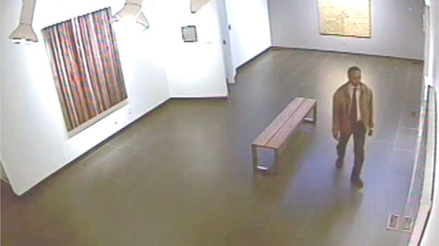 A suspect in a theft and assault investigation is seen in surveillance camera footage. (Toronto Police)