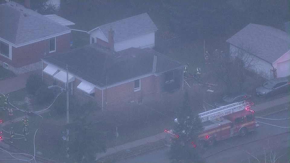 A home on Elmhurst Avenue damaged by fire in North York is shown. (Chopper 24)