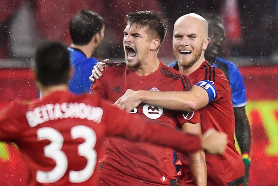 Toronto FC defender Nick Hagglund (6) celebrates his goal against the Montreal Impact with teammates Michael Bradley (4) and Steven Beitashour (33) during second half MLS Eastern Conference playoff soccer final action in Toronto on Wednesday, Nov. 30, 2016. (The Canadian Press/Frank Gunn)