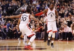 Toronto Raptors' DeMarre Carroll is congratulated by DeMar DeRozan for a three pointer against the Memphis Grizzlies during the second half of NBA basketball action in Toronto on Wednesday, Nov. 30, 2016. (The Canadian Press/Mark Blinch)