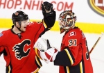 Calgary Flames goalie Chad Johnson, right, and Matt Stajan celebrate their victory over the Toronto Maple Leafs in NHL action in Calgary, Alta., on Wednesday, Nov. 30, 2016. (The Canadian Press/Larry MacDougal)