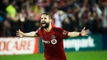 Toronto FC defender Drew Moor (3) reacts after defeating the Montreal Impact during overtime MLS eastern conference playoff soccer final action in Toronto on Wednesday, November 30, 2016. Bill Manning remembers having to sell defender Moor on Toronto FC while trying to recruit him as a free agent last winter. THE CANADIAN PRESS/Nathan Denette