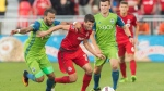 Toronto FC's Mark Bloom battles for the ball with Seattle Sounders' Tyrone Mears, left, and Aaron Kovar, right during first half MLS soccer action, in Toronto on Saturday, July 2, 2016. THE CANADIAN PRESS/Mark Blinch