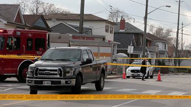Police tape is seen surrounding an intersection in East York after a female pedestrian was struck and killed on Thursday, Dec. 1, 2016. (CP24/John Hanley)