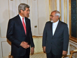 In this Nov. 23, 2014 file-pool photo, Secretary of State John Kerry talks with Iranian Foreign Minister Mohammad Javad Zarif in Vienna, Austria. (AP Photo/Ronald Zak, File-Pool)
