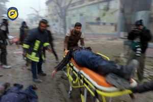 This photo provided by the Syrian Civil Defense White Helmets, which has been authenticated based on its contents and other AP reporting, shows Civil Defense workers carrying a victim on a stretcher after artillery fire struck the Jub al-Quba district in Aleppo, Syria, Wednesday, Nov. 30, 2016. (Syrian Civil Defense White Helmets via AP)