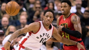 Toronto Raptors guard DeMar DeRozan (10) battles for a loose ball with Atlanta Hawks guard Kent Bazemore (24) during first half NBA action, in Toronto on Saturday, December 3, 2016. THE CANADIAN PRESS/Frank Gunn