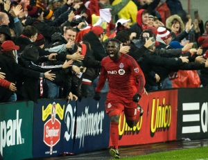 Toronto FC forward Jozy Altidore (17) reacts after scoring past the Montreal Impact during first half MLS eastern conference playoff soccer final action in Toronto on Wednesday, November 30, 2016. THE CANADIAN PRESS/Nathan Denette