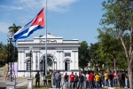 People stand at the entrance of the Santa Ifigenia cemetery where the ashes of Fidel Castro were interred in Santiago, Cuba Sunday, Dec. 4, 2016. Thousands of people lined the short route from the Plaza Antonio Maceo or Plaza of the Revolution to the cemetery where the ashes were buried in a private ceremony near the grave of Cuba's independence hero Jose Marti. (AP Photo/Ricardo Mazalan)