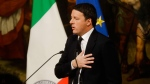 Italian Premier Matteo Renzi speaks during a press conference at the premier's office Chigi Palace, in Rome, early Monday, Dec. 5, 2016. Renzi acknowledged defeat in a constitutional referendum and announced he would resign on Monday. Italians voted Sunday in a referendum on constitutional reforms that Premier Matteo Renzi has staked his political future on. (AP Photo/Gregorio Borgia)