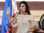 "FILE- In this June 30, 2016 file photo, Philippine Vice President Leni Robredo is sworn in during inauguration ceremonies in suburban Quezon city, north of Manila, Philippines. The Philippine vice president says she will resign her Cabinet post, citing ""major differences in principles and values"" with President Rodrigo Duterte and an unspecified plot to remove her from the vice presidency. Leni Robredo said Sunday, Dec. 4, 2016 that she will resign Monday as housing secretary, an appointment made by Duterte, but will stay on in her elected post as vice president. (AP Photo/Aaron Favila, File)"