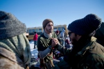 Marine Corps veteran Maurilio Martins, center, and Nesky Hernandez, right, both of Miami, greet one another after arriving at the Oceti Sakowin camp where people have gathered to protest the Dakota Access oil pipeline in Cannon Ball, N.D., Sunday, Dec. 4, 2016. The U.S. Army Corps of Engineers said Sunday that it won't grant an easement for the Dakota Access oil pipeline in southern North Dakota, handing a victory to the Standing Rock Sioux tribe and its supporters, who argued the project would threaten the tribe's water source and cultural sites. (AP Photo/David Goldman)