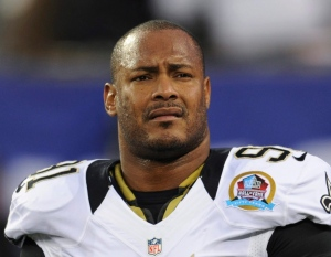 In this Dec. 9, 2012, file photo, New Orleans Saints defensive end Will Smith appears before an NFL football game against the New York Giants in East Rutherford, N.J. The trial for Cardell Hayes charged with second-degree murder in the April 9, 2016, shooting death of Smith begins with jury selection Monday, Dec. 5, 2016. (AP Photo/Bill Kostroun, File)