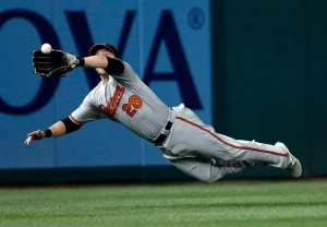 Baltimore Orioles left fielder Steve Pearce dives to catch a ball hit by Washington Nationals Daniel Murphy during the fourth inning of a baseball game at Nationals Park Thursday, Aug. 25, 2016, in Washington. (AP Photo/Alex Brandon)