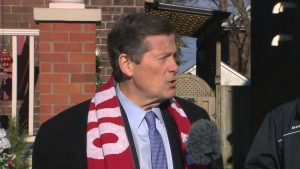 Mayor Tory speaks with reporters outside a home near Avenue Road and St. Clair Avenue on Monday.