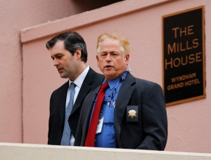 Michael Slager, left, walks from The Mills House Hotel to the Charleston County Courthouse under the protection from the Charleston County Sheriff's Department during a break in the jury deliberations for his trial Monday, Dec. 5, 2016, in Charleston, S.C.  (AP Photo/Mic Smith)