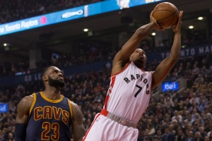 Toronto Raptors guard Kyle Lowry (right) shoots past Cleveland Cavaliers forward LeBron James during first half NBA basketball action in Toronto on Monday, December 5, 2016. THE CANADIAN PRESS/Chris Young