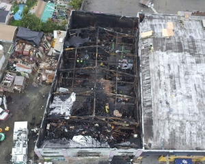 This photo provided by the City of Oakland shows inside the burned warehouse after the deadly fire that broke out on Dec. 2, 2016, in Oakland, Calif. The death toll in the fire climbed Monday, Dec. 5, with more bodies still feared buried in the blackened ruins, and families anxiously awaited word of their missing loved ones. (City of Oakland via AP)