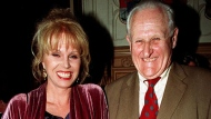 """In this April 29, 1998 file photo, actress  Joanna Lumley, left and actor Peter Vaughan, pose for a photo, in London. Veteran British character actor Peter Vaughan, who played the enigmatic Maester Aemon in """"Game of Thrones,"""" has died aged 93. Vaughan's agent Sally Long-Innes says he died Tuesday, Dec. 6, 2016 surrounded by his family. (Fiona Hanson/PA via AP, File)"""