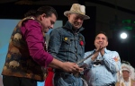 """Assembly of First Nations Chief Perry Bellegarde looks on as Lakota Sioux Donnie Speidel (left) honours singer Gord Downie with an eagle feather and name at the AFN Special Chiefs assembly in Gatineau, Que., on Tuesday, Dec. 6, 2016. Downie was given the name """"The Man Who Walks Among the Stars,"""" during the ceremony. (The Canadian Press/Adrian Wyld)"""