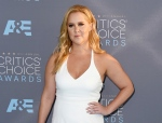 """FILE - In this Jan. 17, 2016, file photo, Amy Schumer arrives at the 21st annual Critics' Choice Awards in Santa Monica, Calif. Schumer called out critics who slammed her potential casting as Barbie in an upcoming live-action film based on the Mattel doll. Schumer posted a picture of herself in a swimsuit on Instagram Tuesday, Dec. 6, 2016. She says those who attempted to fat shame her have failed because she knows she's not fat and has """"zero shame"""" in her game. (Photo by Jordan Strauss/Invision/AP, File)"""