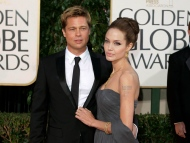 In this Jan. 15, 2007, file photo, actor Brad Pitt and actress Angelina Jolie arrive for the 64th Annual Golden Globe Awards in Beverly Hills, Calif.  (AP Photo/Mark J. Terrill, File)