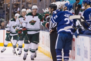 Minnesota Wild centre Eric Staal (centre) celebrates scoring against the Toronto Maple Leafs during second period NHL hockey action in Toronto on Wednesday, Dec. 7, 2016. (The Canadian Press/Chris Young)