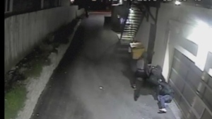 Police have released video surveillance footage of three suspects wanted in connection with an attack in a downtown alleyway last weekend.