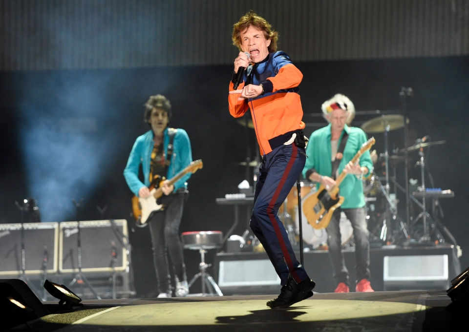 In this Oct. 7, 2016 file photo, Mick Jagger, center, performs with Ron Wood, left, and Keith Richards of the Rolling Stones during their performance on day 1 of the 2016 Desert Trip music festival at Empire Polo Field in Indio, Calif. Jagger, the 73-year-old frontman of the Rolling Stones, was on hand Thursday, Dec. 8, 2016 at a New York hospital when girlfriend, Melanie Hamrick, gave birth to the couple's son. (Photo by Chris Pizzello/Invision/AP)
