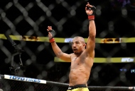 Jose Aldo celebrates after defeating Frankie Edgar during their featherweight championship mixed martial arts bout at UFC 200 on Saturday, July 9, 2016, in Las Vegas. (The Canadian Press/AP, John Locher)
