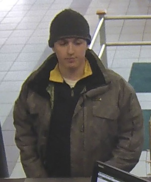 A suspect in a series of Yonge Street bank robberies is shown in this surveillance camera image. (Toronto Police Service)