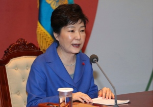 South Korean President Park Geun-hye speaks during an emergency Cabinet meeting at the presidential office in Seoul, South Korea, Friday, Dec. 9, 2016. South Korean lawmakers earlier on Friday impeached Park, a stunning and swift fall for the country's first female leader amid protests that drew millions into the streets in united fury. (Baek Sung-ryul/Yonhap via AP)
