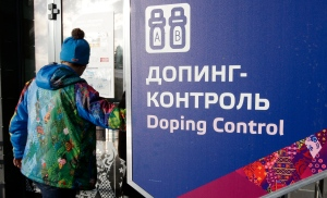 In this Feb. 21, 2014, file photo, a man walks past a sign reading doping control, at the Laura biathlon and cross-country ski center, at the 2014 Winter Olympics in Krasnaya Polyana, Russia. (AP Photo/Lee Jin-man, File)