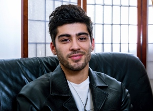 """In this Oct. 28, 2016, file photo, singer Zayn Malik, formerly of One Direction, poses for a portrait in West Hollywood, Calif., to promote his new book, """"Zayn."""" Malik has teamed with former Taylor Swift for the surprise duet, """"I Don't Wanna Live Forever"""" released on Friday, Dec. 9, 2016. (Photo by Willy Sanjuan/Invision/AP, File)"""