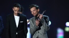 Members of the band One Direction, Liam Payne, left, and Louis Tomlinson accept the award for Best British Video at the Brit Awards 2016 at the 02 Arena in London, Wednesday, Feb. 24, 2016. (Photo by Joel Ryan/Invision/AP)
