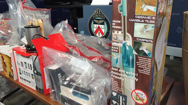A raft of counterfeit goods are displayed at Toronto Police HQ on Dec. 9. (Arda Zakarian/CP24)