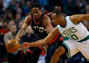 Boston Celtics guard Avery Bradley strips the ball from Toronto Raptors' DeMar DeRozan during the first quarter of an NBA basketball game in Boston on Friday, Dec. 9, 2016. (AP Photo/Winslow Townson)