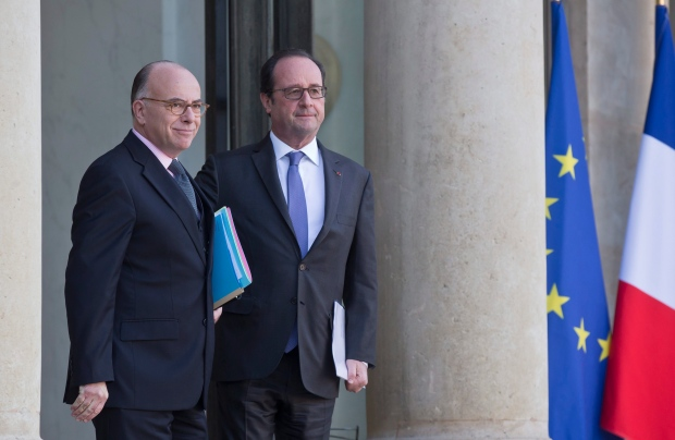 New French Prime Minister Bernard Cazeneuve, left, and French President Francois Hollande walk out of the Elysee Palace in Paris after the weekly cabinet meeting, Wednesday, Dec. 7, 2016. (AP Photo/Michel Euler)