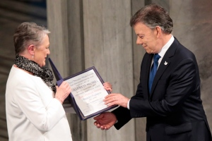 Nobel Peace Prize Laureate Colombian President Juan Manuel Santos receives the medal and diploma from Norwegian Nobel Committee member Berit Reiss-Andersen during the Peace Prize awarding ceremony at the City Hall in Oslo, Saturday Dec. 10, 2016. President Juan Manuel Santos is awarded this year's Nobel Peace Prize for his efforts to bring Colombia's more than 50-year-long civil war to an end. (Lise Aaserud/ NTB scanpix via AP)